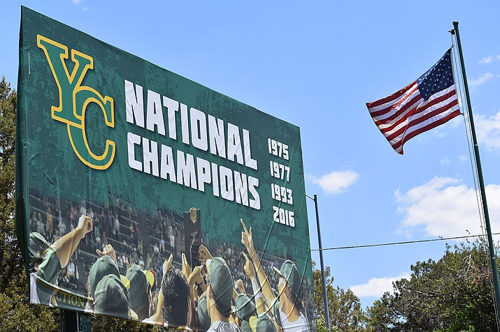 A national championship board at Yavapai College's Roughrider Park reflects the success of the baseball program.