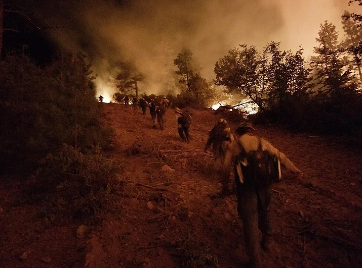 Firefighters hike up a hill during burnout operations on the Goodwin Fire July 1.