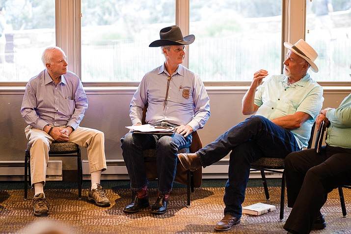 Tusayan Mayor John Rueter discusses with Senator John McCain (left) and Arizona Legislator Bob Thorpe (center) concerns a possible designation of a Grand Canyon Watershed National Monument could have for the town of Tusayan.