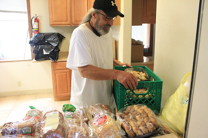 Chuck Hoag unloads groceries at the Williams Food Pantry and More.