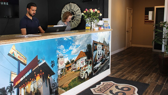 Ramada Inn general manager Sultan Abbas, left, and clerk Valicity Plumley work the front desk at the 95-room hotel off Interstate 40 at Andy Devine Avenue. The hotel has seen an increase in cancellations from tour groups, particularly of international origin.