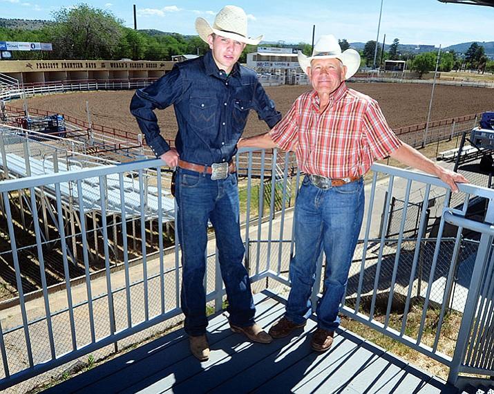 J.C. Mortensen, with his grandfather, 1981 World Champion Bareback rider J.C. Trujillo, poses at the Prescott Rodeo Grounds.