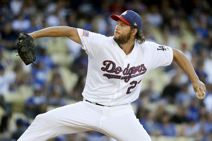 Dodgers starting pitcher Clayton Kershaw throws against the Diamondbacks during Tuesday's game in Los Angeles.