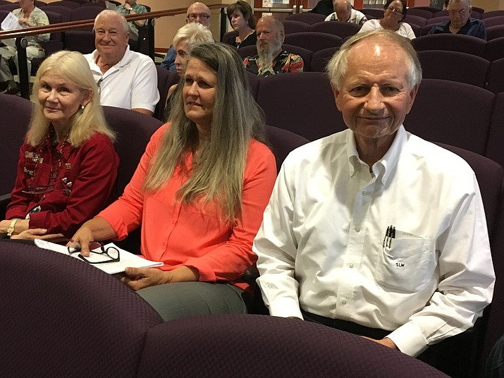 Steven Wilmeth, right, president of Scot Industries, sits with his wife, Victoria, left, and real estate representative Kathy Tackett-Hicks, during Monday's Mohave County Board of Supervisors meeting. The board voted to approve several zoning changes for 240 acres around Shinarump Drive and Oatman Road in the Golden Valley area, where Scot Industries plans to build a new pipe manufacturing plant.