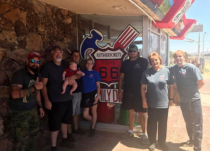 Adam Lingo (left) and Joseph Cox (center in black) stopped in Kingman on their cross-country walk to raise awareness for veteran suicides.
