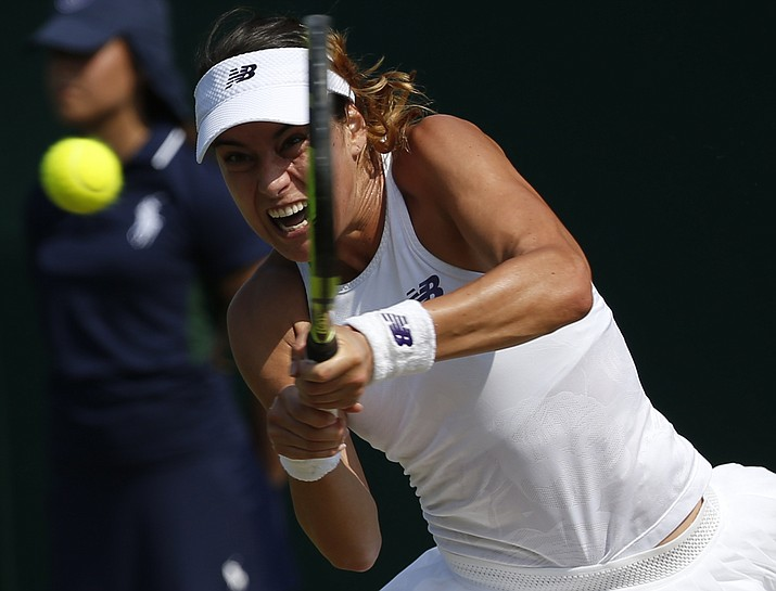Romania's Sorana Cirstea returns to Bethanie Mattek-Sands of the United States during their Women's Singles Match on day four at the Wimbledon Tennis Championships in London Thursday, July 6.