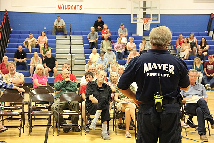 Michael McGhee, Mayer Fire Department Battalion Chief, speaks during a Goodwin Fire community meeting about post-fire flooding potential. The meeting took place at Mayer High School on Wednesday, July 5. (Max Efrein/Courier)