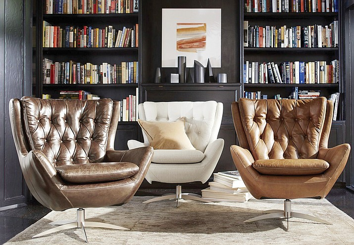 This undated photo provided by Pottery Barn shows the Wells swivel chair by Pottery Barn. With a nod to mid-century modern style, the Wells swivel chair incorporates classic detailing like tufting and the wing silhouette. (Pottery Barn via AP)