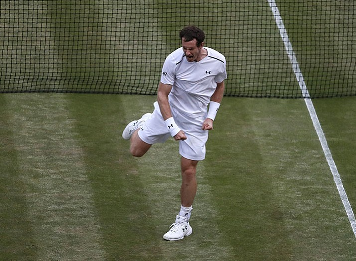 Britain's Andy Murray celebrates after winning against Italy's Fabio Fognini after their Men's Singles Match on day five at the Wimbledon Tennis Championships in London Friday, July 7.