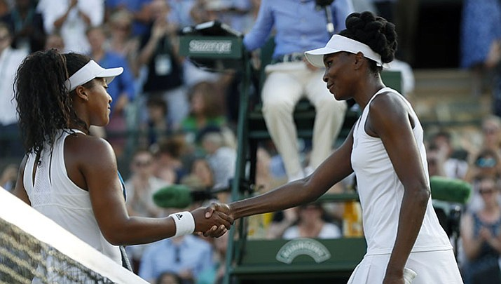 Venus Williams of the United States, right, shakes hands with Japan's Naomi Osaka after winning in their Women's Singles Match on day five at the Wimbledon Tennis Championships in London Friday, July 7.