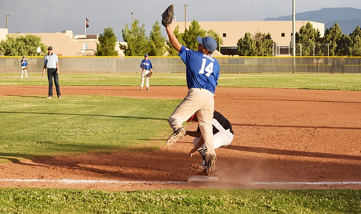 Camp Verde's Jose Santana jumps to make a catch against Wickenburg on Thursday in the first round of the District 10 Juniors all-star tournament. Because of byes and forfeits, Camp Verde and Wickenburg was the only first round game of the tournament. (VVN/James Kelley)