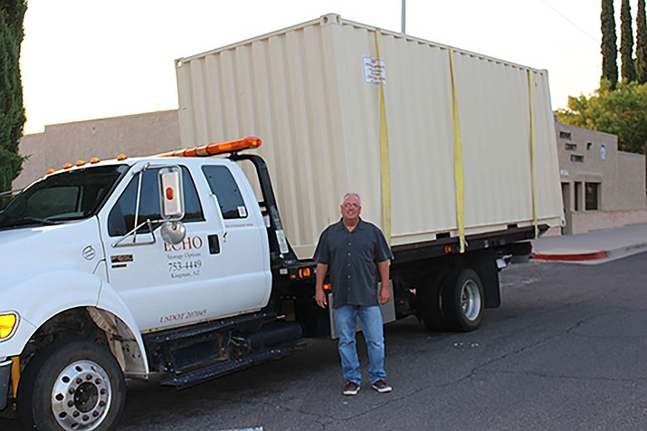Jim Hodges of Echo Storage Options of Golden Valley parked a 20-foot storage container outside City Hall in August for a Planning and Zoning Commission workshop on containers. Storage containers may continue to be used downtown after Tuesday's council meeting.