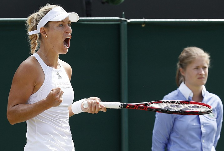 Germany's Angelique Kerber celebrates after winning a point against Shelby Rogers of the United States during their match at the Wimbledon Tennis Championships (Kirsty Wigglesworth/AP)
