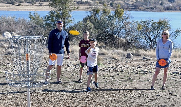 The Streeter family plays disc golf at the Watson Lake course.