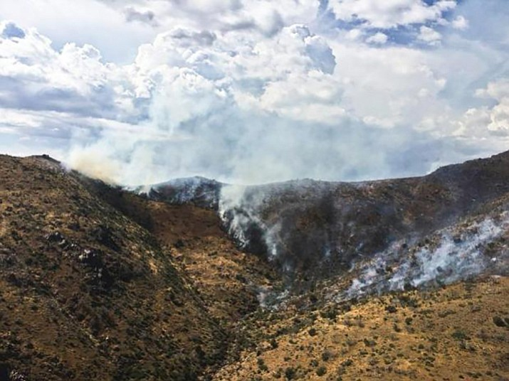 The Bull Fire smoldering on steep rocky terrain Monday, July 10. (Forest Service/Courtesy)