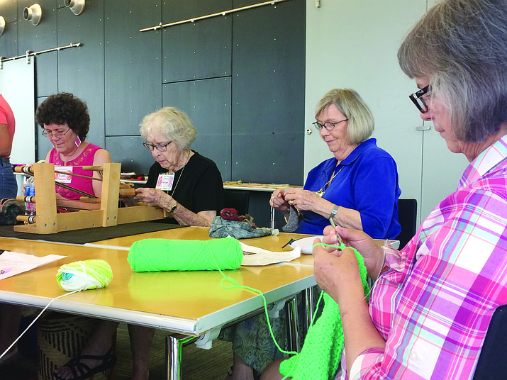 Jean LeFever (right) works on a project at Crochet One, Knit Too!