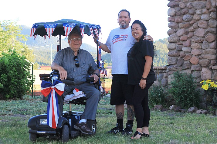Dick Boline, father of Williams resident Kelly Osborne, is all smiles after receiving a motorized scooter from Don and Michelle Mackay.