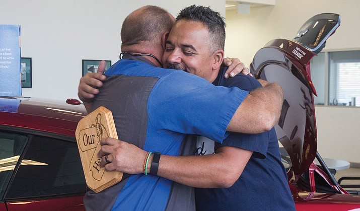 "Jason Setter hugs Dion Loyd, saying that ""These guys are now friends for life."" 