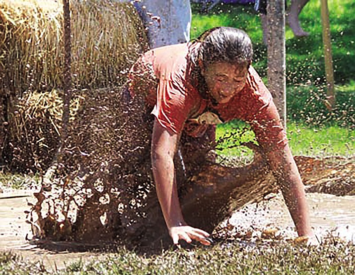 Vanessa Blanco falls into the mud during the 2012 Mud Mania. Mud Mania returns at 10 a.m. Thursday at Firefighter's Memorial Park, 2201 Detroit Ave.