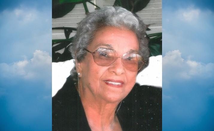 Carmen M. Trinidad