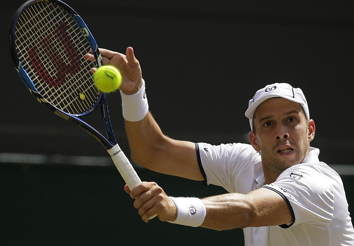 Luxembourg's Gilles Muller returns to Croatia's Marin Cilic during their men's singles quarterfinal on day nine at the Wimbledon Tennis Championships in London Wednesday, July 12.