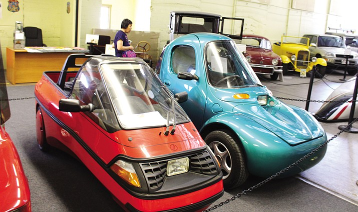 The Historical Electric Vehicle Museum added a bright red 1993 Danish-built City-El, left, donated by Karl Knapp of Palo Alto, California, along with a 2000 Corbin Sparrow, right, that received a glistening coat of original teal blue paint from Dream Machines custom body and paint shop in Kingman. It was donated by Yvette Subramanian of Orinda, California.