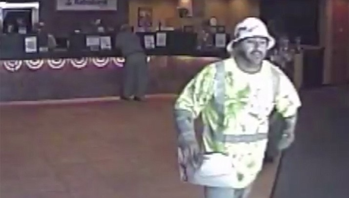 Investigators say Francisco Hernandez was caught on surveillance video June 30 entering a bank, pulling a semi-automatic handgun from a large envelope and demanding money. (Ventura Police Department Photo)