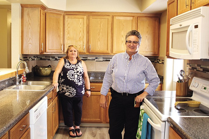 Lisa Samstag, right, owner of a home for sale on Robinson Avenue, and her real estate agent, Brenda Goodman, uncovered a scam on Craigslist to rent the three-bedroom, one-bath home for $600 a month. The scammer wanted first month's rent and security deposit wired to him.