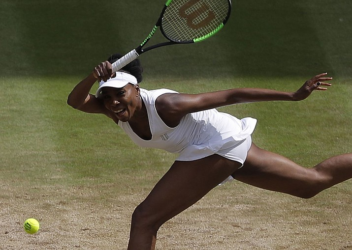 Venus Williams of the United States returns to Britain's Johanna Konta during their Women's Singles semifinal match on day nine at the Wimbledon Tennis Championships in London Thursday, July 13, 2017. (Alastair Grant/AP)