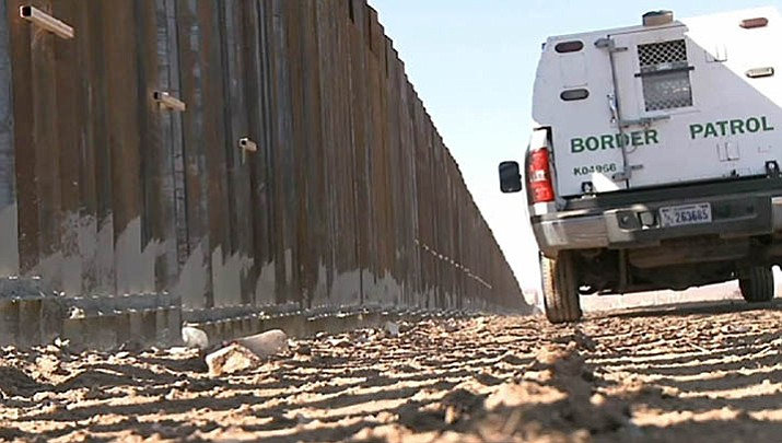 A Border Patrol vehicle rides the border fence near Douglas, Arizona, in this 2012 file photo.