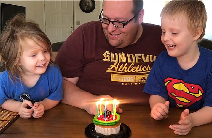 "Emma, left, and A.J. sing ""Happy Birthday"" to Brian on Friday, July 14."