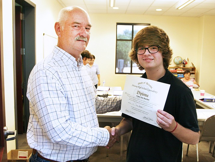 "Camp Verde Adult Reading Program Director Doug Watson, left, with Rimrock resident Caden Bartlett, who earned his GED in December 2016. ""He's a very bright young man,"" Watson said of Bartlett, 18. ""He just needed a little push to get going in the right direction."" (Photo by Bill Helm)"