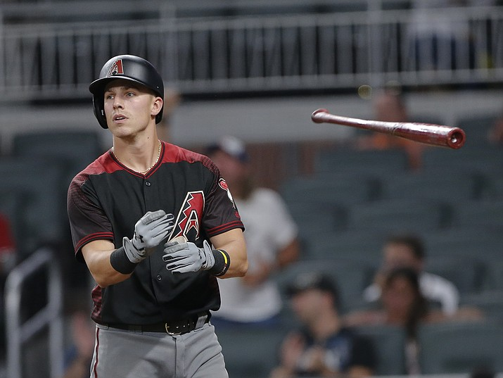 Arizona Diamondbacks' Jake Lamb tosses his bat after striking out in the eighth inning of a baseball game against the Atlanta Braves, Saturday, July 15, 2017, in Atlanta. (John Bazemore/AP)