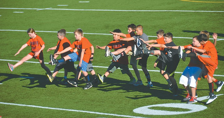 Campers warm up at the Mingus Youth Football Camp in 2015. Mingus Union is hosting their annual kids football camp Tuesday through Thursday and Camp Verde has theirs Monday through Thursday. (VVN/ Vyto Starinskas)