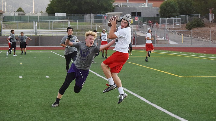 Mingus Union senior Tyler Kelly catches a touchdown pass against Cesar Chavez on Thursday at home. Mingus Union hosted the Champions and Sedona for 7-on-7 games. (VVN/James Kelley)