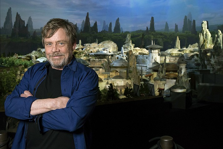 Mark Hamill, from the upcoming film 'Star Wars: The Last Jedi,' was among the first to see a fully detailed model of Disney Parks' new Star Wars-themed land. It was announced at the Disney fan event that the all-new 14-acre land will be called 'Star Wars: Galaxy's Edge' when it opens in 2019 at Disneyland Resort in California and Walt Disney World Resort in Florida. (Joshua Sudock/Disney Parks via AP)