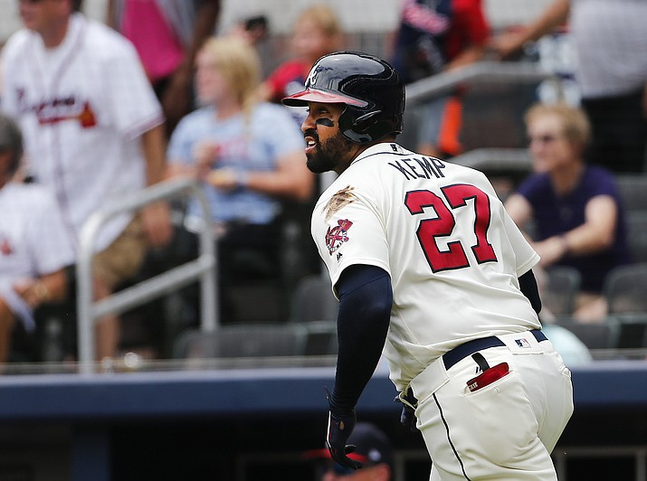 Atlanta Braves left fielder Matt Kemp (27) watches his three-run home run leave the ballpark in the third inning against Arizona on Sunday, July 16, 2017. (John Bazemore/AP)