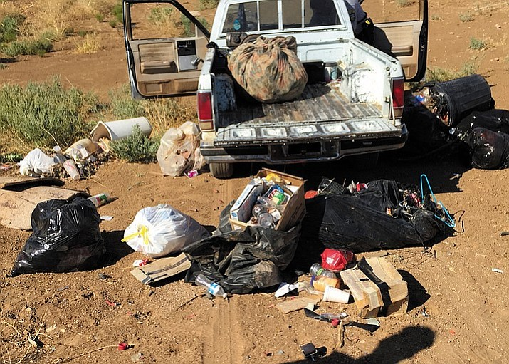 The Mohave County Environmental Rural Area Cleanup Enforcement detectives received a phone call from a witness about a man dumping trash in the desert near Kingman Wednesday. An investigation led to an area where they watched Christopher McKinney, 35, allegedly unload trash debris from a truck bed while parked in a gully.