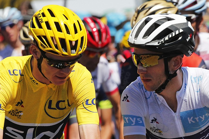 Britain's Chris Froome, wearing the overall leader's yellow jersey, and Britain's Simon Yates, wearing the best young rider's white jersey, wait for the start of the 15th stage of the Tour de France over 117.8 miles with start in Laissac-Severac l'Eglise and finish in Le Puy-en-Velay, France, on Sunday, July 16, 2017. (Christophe Ena/AP)