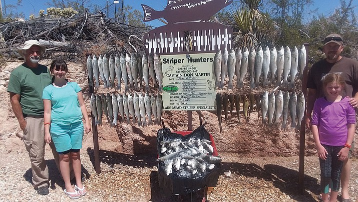 That's a lot of fish. Greg Smith, Deborah Smith, Quinn Reaves and Wade Reaves (L-R) show the 142 fish they caught on a trip the young ladies earned while attending a recent Hunter Education class.