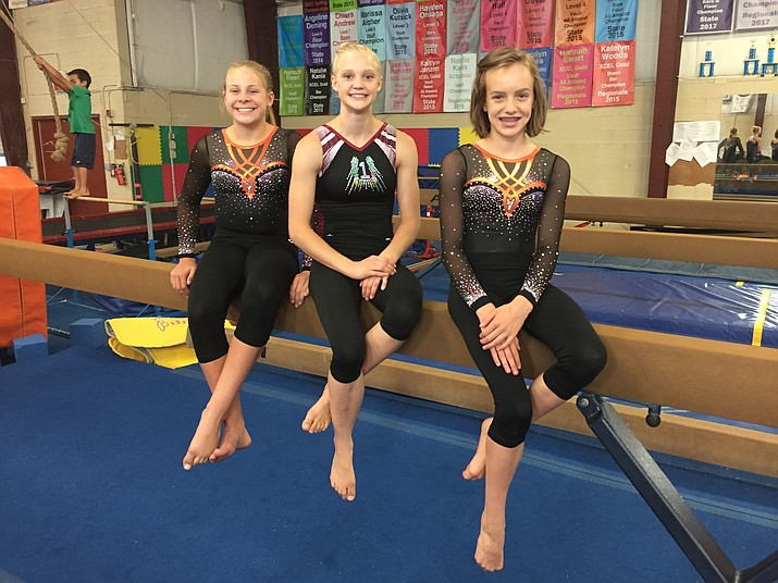 From left to right: Katie Janzen, Anna Bramblett and Adalyn Andrew, posing for a photo Monday, July 17, 2017, are all members of Arizona Dreams Gymnastics in Prescott Valley. (Kevin Huton/Courier)