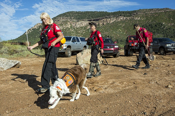 Volunteer rescuers from Navajo County begin searching for a missing 27-year-old man in Tonto National Forest on Monday, July 17, 2017. The man was swept downriver with more than a dozen others when floodwaters inundated the area on Saturday.