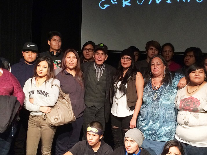 Rudy Ramos (center) visits with students from Sherman Hills Indian School, an Apache boarding school, in Riverside, California, after a performance of 'Geronimo: Life on the Reservation.'