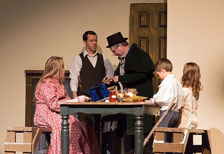 "Mr. Scrooge visits the Cratchet family in the Beale Street Theater's wildly successful performance of ""The Scrooge,"" in December."