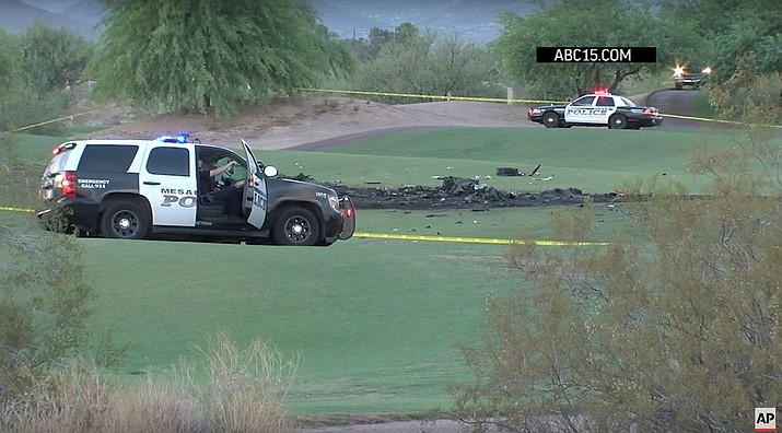 Authorities say two people are dead after a small plane crashed on a golf course in Mesa, Arizona on Monday. The FAA says the plane reported mechanical trouble and could not reach a nearby airport. (ABC News screenshot vis AP)