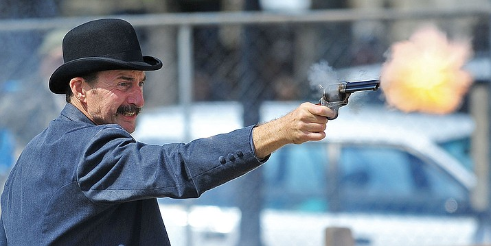 Sheriff Amos Johnson, played by Al Freehauf, participates in a gun battle during the 8th Annual Shootout on Whiskey Row in downtown Prescott.