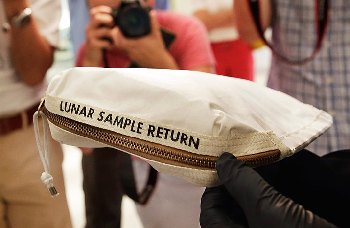 The Apollo 11 Contingency Lunar Sample Return Bag used by astronaut Neil Armstrong, to be offered at auction, is displayed at Sotheby's, in New York, July 13. (Richard Drew/AP Photo)