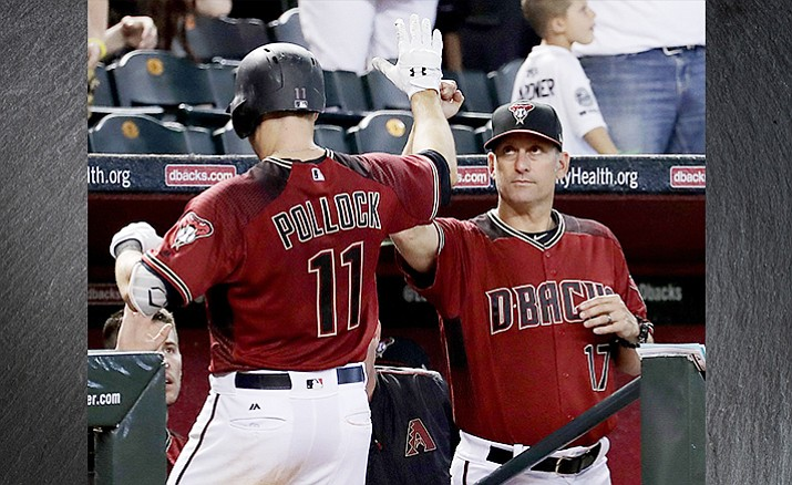 Arizona Diamondbacks' A.J. Pollock, left, greets manager Torey Lovullo (17) after hitting a solo home run against the Cincinnati Reds during a baseball game, Sunday, July 9, 2017, in Phoenix. (AP Photo/Matt York)