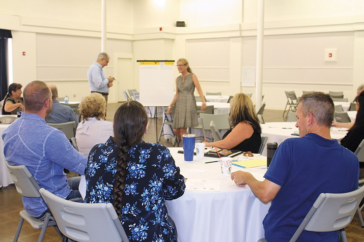 "Lani Lott, standing on right, and Jim McPherson lead one of three Main Street Arizona Town Hall workshops Thursday at Beale Celebrations. More than a dozen business owners and city officials attended the second workshop on ""Business Communication and Mix."""