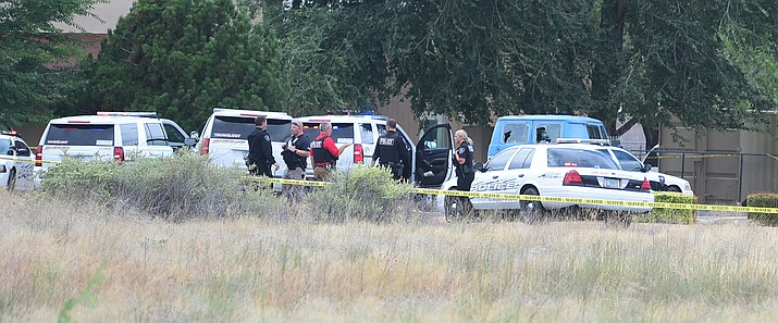 Chino Valley Police and Yavapai County Sheriff's deputies at the scene of an officer involved shooting in the 400 block of Palomino  Road in Chino Valley Friday, July 21.